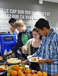 Students getting healthy snacks from a buffet