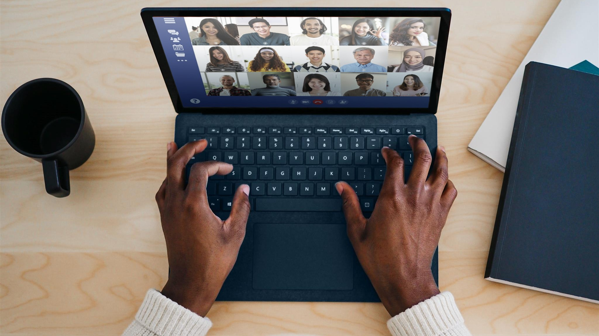 A person doing a video call with multiple other people.